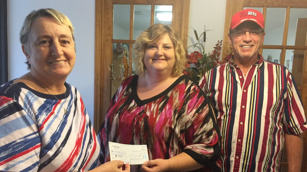 Account Executive Carrie Schimweg (middle) presents $100 check to Donna Buhler (Left), the winner of our Christmas Cash Extravaganza for the week of November 18, 2016.