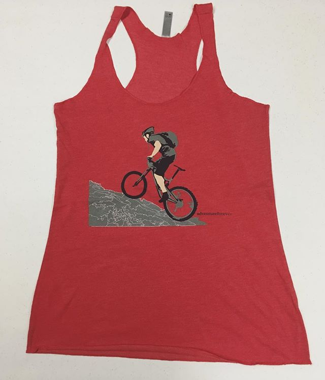 Summertime isn't complete without a go to tank. We have several of these mountain bike women's tanks in red and brown available. Comfy enough your  ride, but just as good for after. #summer #tanktop #mountainbike #mtnbike #girlpower #getoutandride #outside #mountainbiking #outdoorwomen