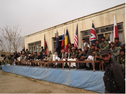 Afghan dignitaries and a U.S. colonel share a table with a prime view of the action. (Photo courtesy: Josh Walters)