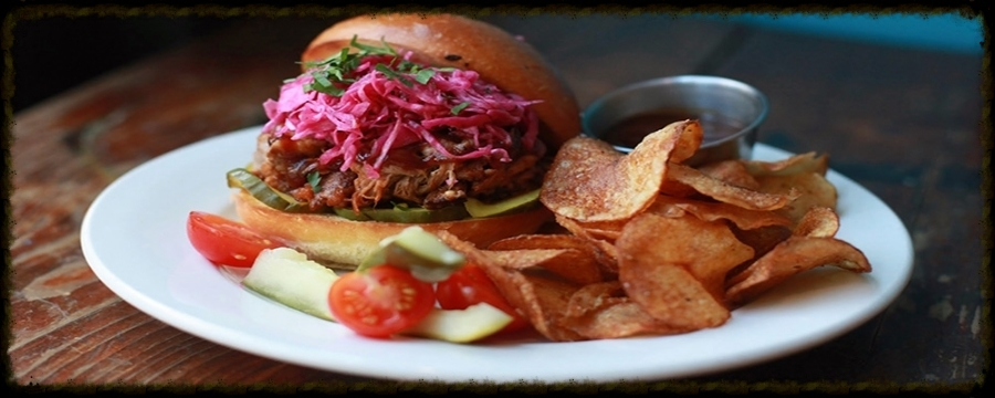 Heritage Pulled Pork Sandwich on Brioche. Served with Homemade chips.