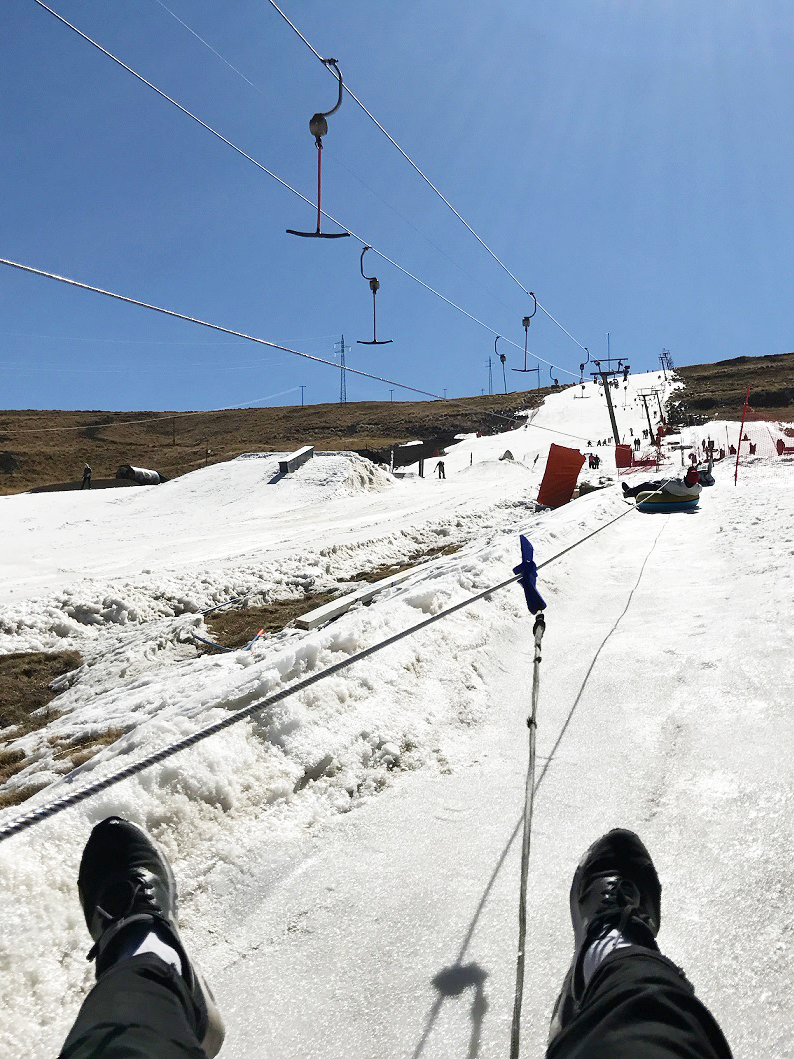 feet_ski_lift_tbar_snowy_slopes