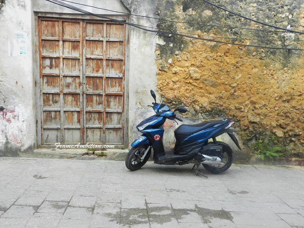 A Swahili door and a blue scooter across from my hostel on Gizenga Street