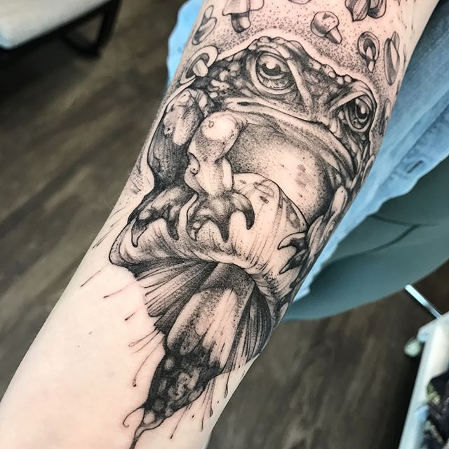"I really enjoyed this grumpy toad a little too much.  And with 13 little mushrooms 🍄 swirling around his head, technically it's my first ""Friday the 13th"" tattoo... 👏🏻🧟‍♂️🐸"