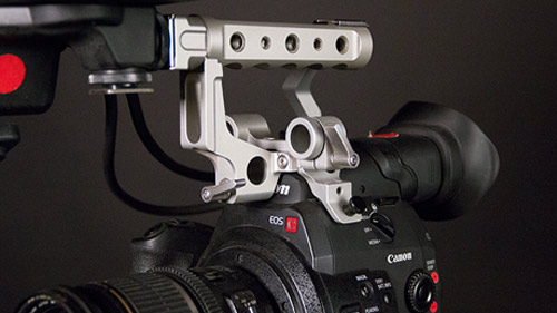 MovCam top handle features three 15mm rod holes for mounting gear.