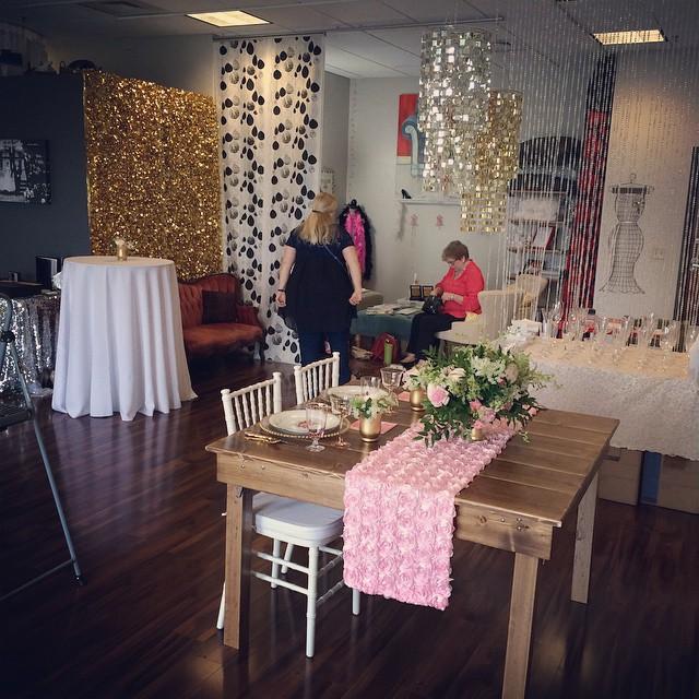 Behind the scenes, preparing for a wedding vendor boutique.