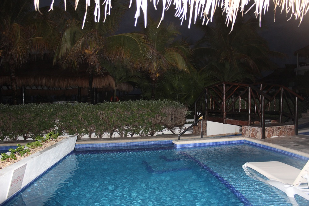 View of our pool at night!