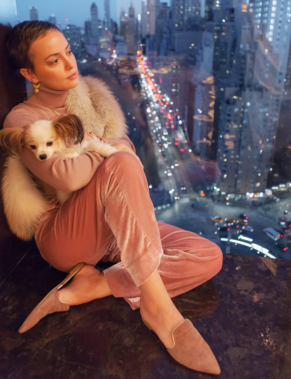 Kelly Framel and her pup gaze over the spectacular Columbus Circle view from Mandarin Oriental New York's restaurant Asiate. (Photo c/o Kelly Framel, 2018)
