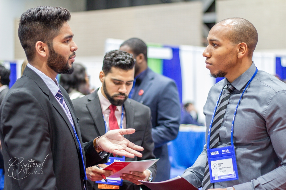 Prospects Omar (left) Ibrahim (middle) talking to Solomon Laws, Project Manager with Gilbane (right, my husband)