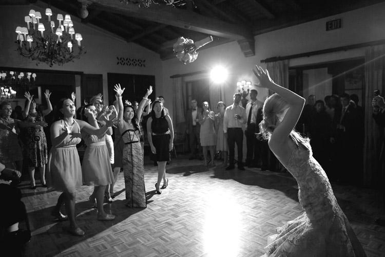 bouquet toss wedding photo