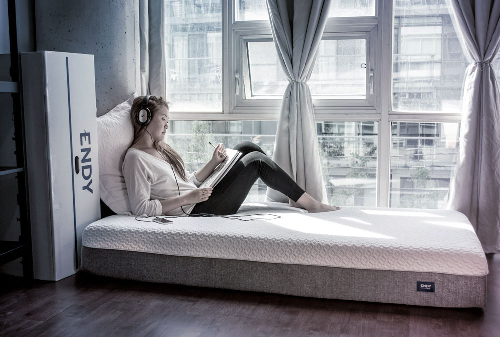 The Endy Mattress featured in an urban loft setting, 2015.