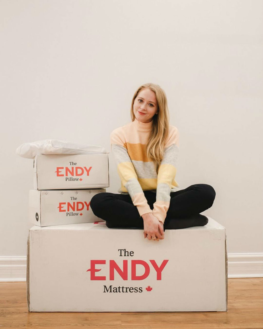 """Natalie Ast (@natalieast) - Ast is a Toronto-based lawyer who also maintains a blog dedicated to fashion, style, and travel.""""New city, new apartment, new bed. So excited to be partnering with @endy to get a better night's sleep! 😴First step was getting a new bed set up. I was so impressed that the #Endy mattress came shipped in a box I could lift on my own, and that it arrived by an eco-friendly bike courier! 🚴♂️ I also love that the company is all Canadian, manufactured and shipped locally. 🇨🇦"""""""