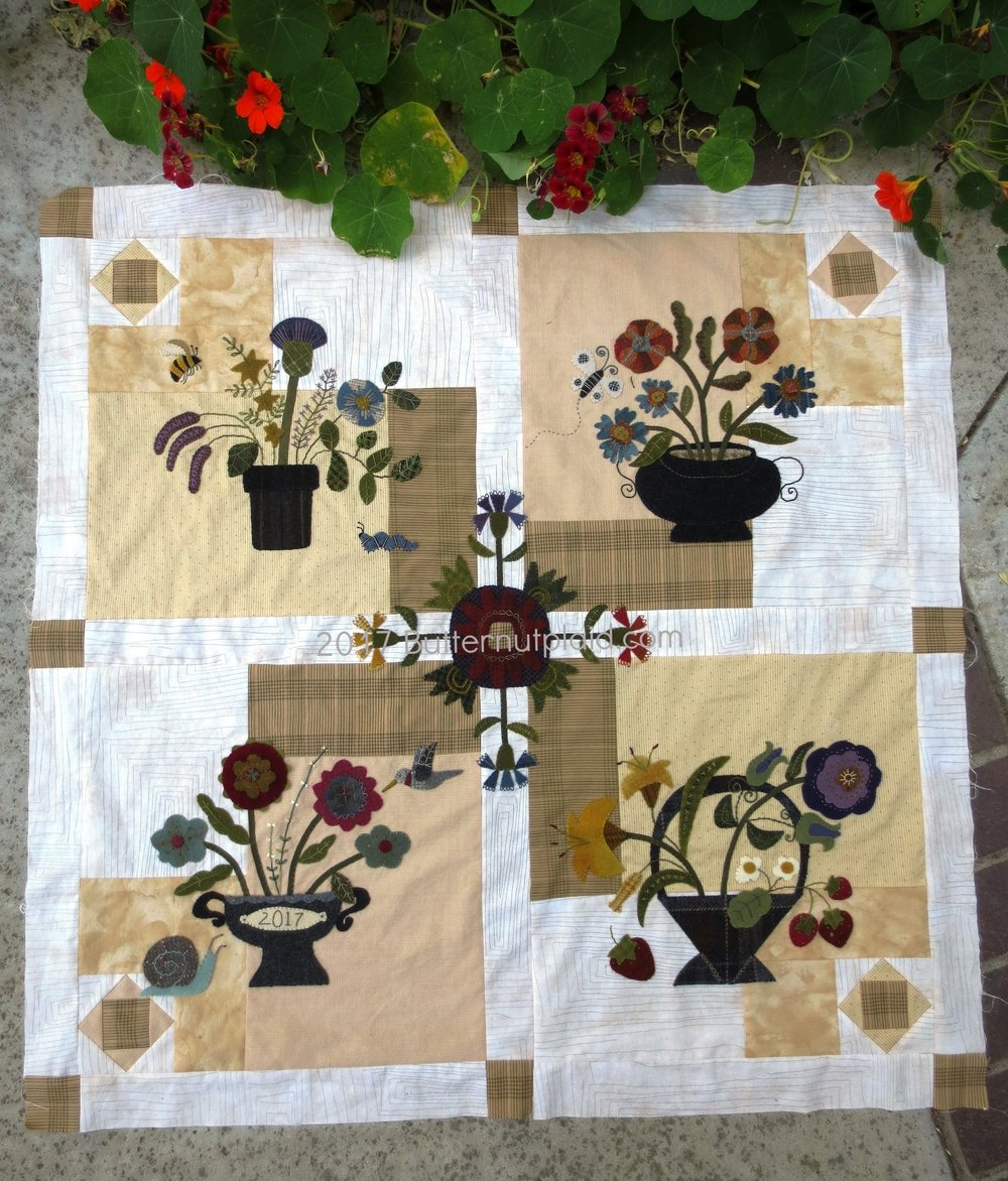 Flowers From My Garden Mystery Quilt - Adding the corner blocks, sashing, and center wool applique.