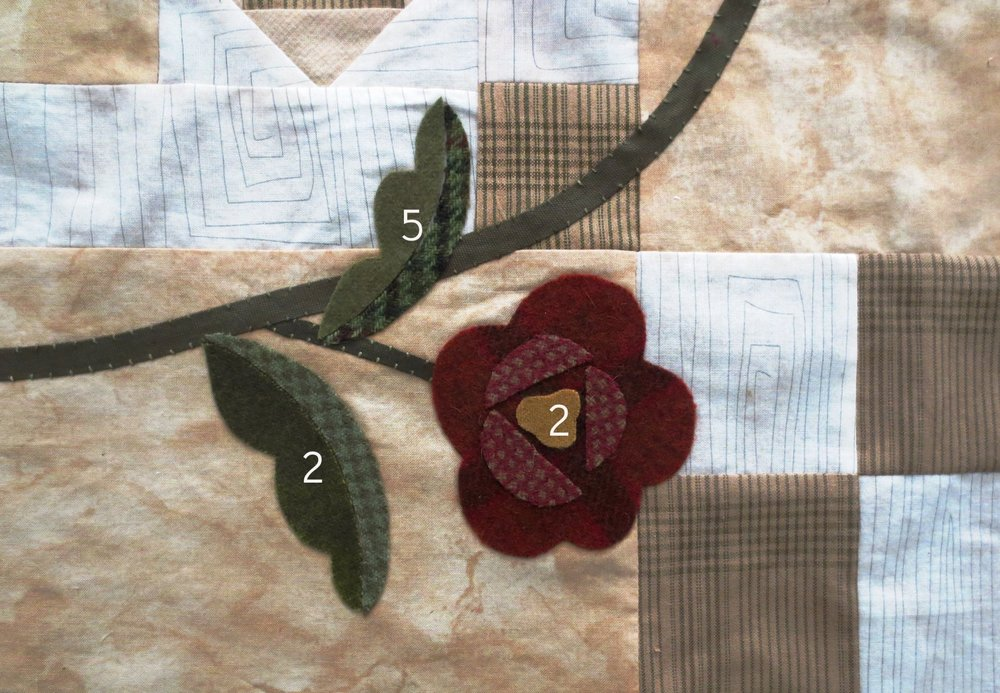 This flower is located on the lower right hand corner of the quilt. Use the blocks for reference.