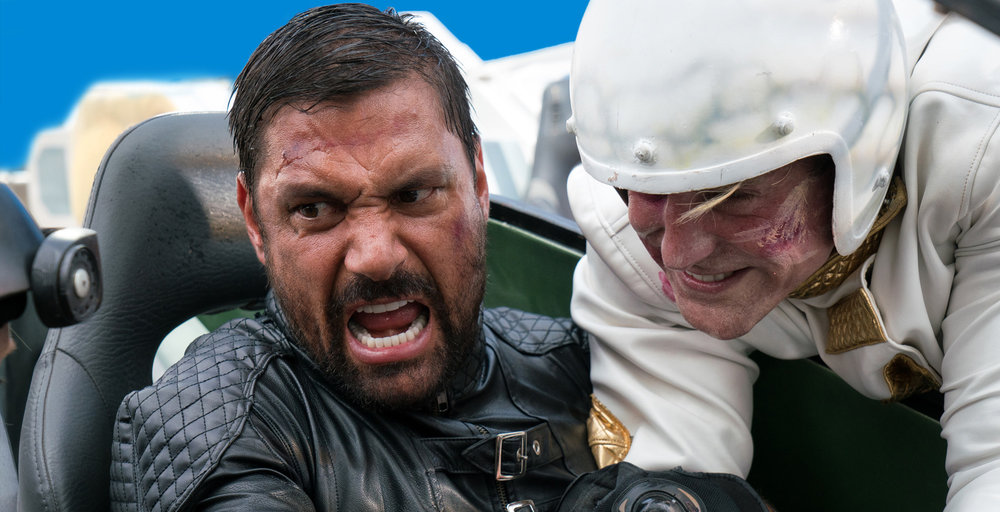 Frankenstein (Manu Bennett) and Jed Perfectus (Burt Grinstead) fight for control of a vehicle in Death Race 2050.