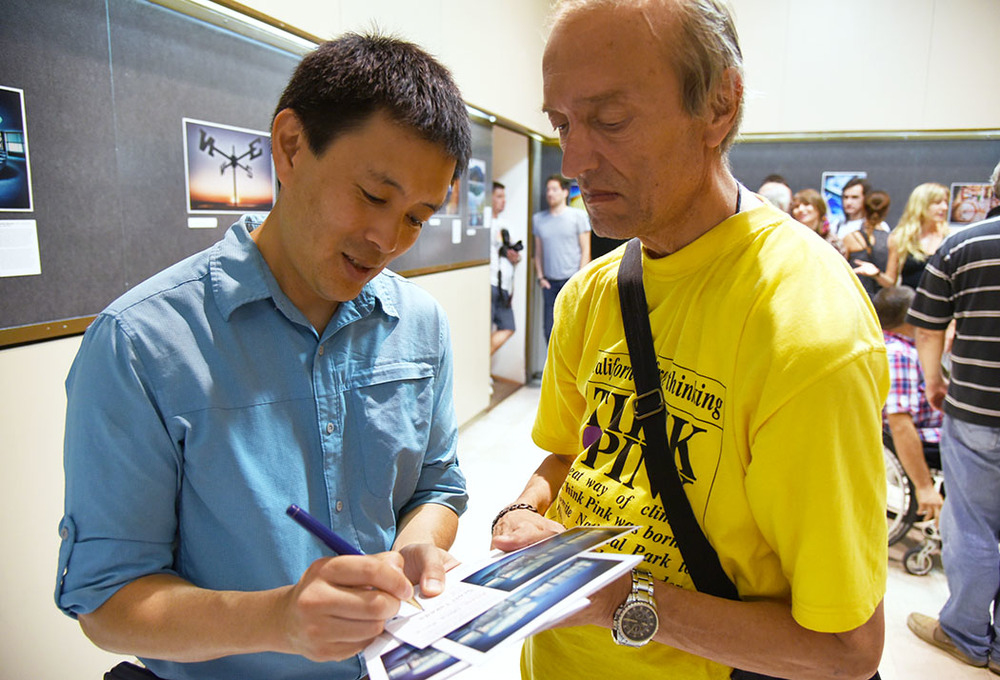 Art photographer signs autographs to Croatian fans at his art show at the Fotoklub Split Gallery in Split, Croatia. (August 2015)