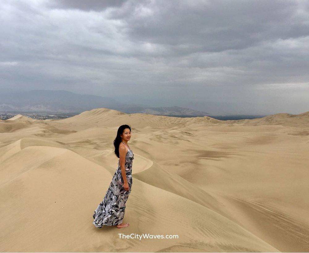 Vehllia standing Huacachina Peru.jpg
