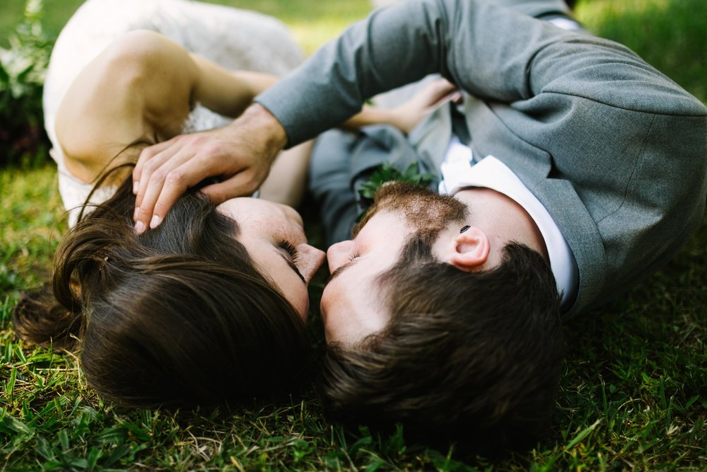 bride-and-groom-lying-in-the-grass.jpg
