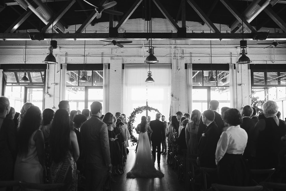 A black and white photo of the ceremony at this Battello Wedding in Jersey City, NJ