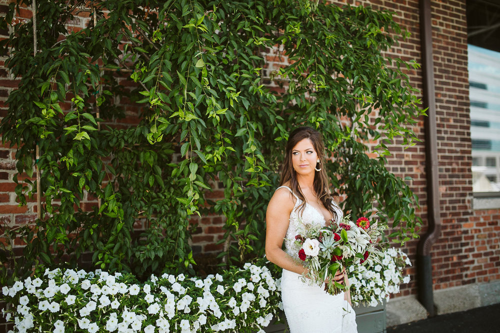 Bridal portrait against a green and brick wall at this Battello Wedding in Jersey City, NJ