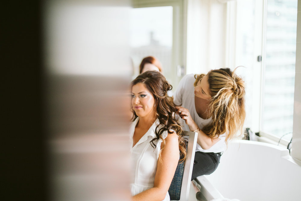 The bride getting her hair done at this Battello Wedding in Jersey City, NJ