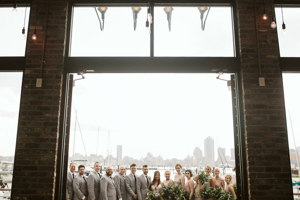 The bridal party at the marina at this Battello Wedding in Jersey City, NJ
