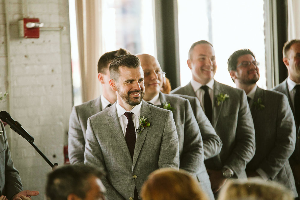 The groom's reaction to the bride walking down the aisle at this Battello Wedding in Jersey City, NJ