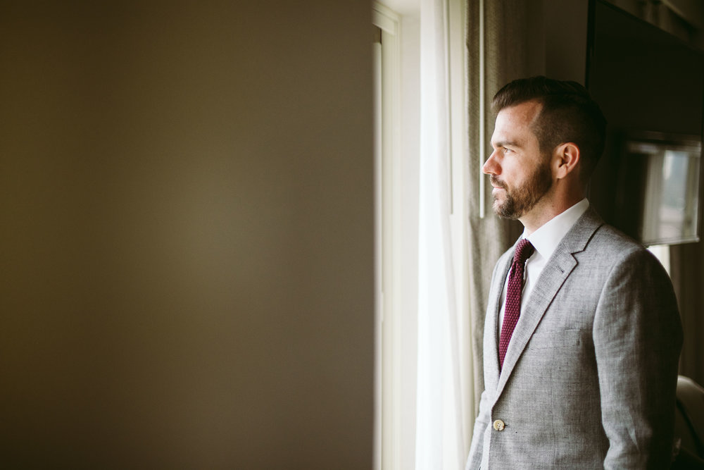 A portrait of the groom before the wedding at this Battello Wedding in Jersey City, NJ