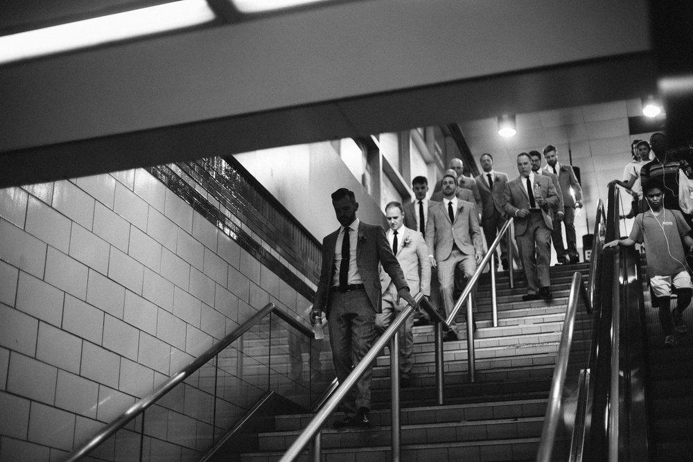 groomsmen-in-nyc-subway.jpg