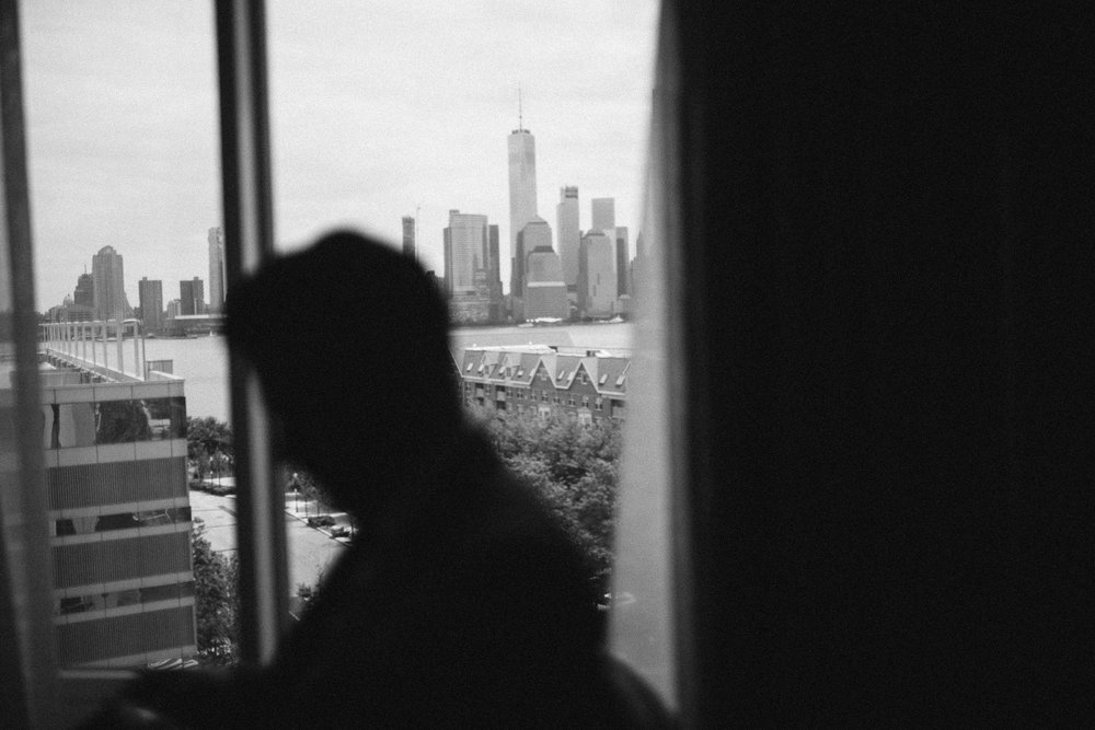 A black and white silhouette photo of the groom with a city backdrop at this Battello Wedding in Jersey City, NJ