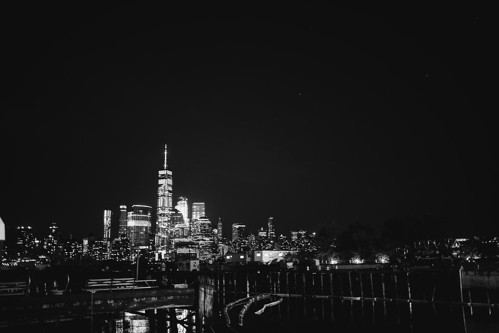 A black and white photo of the NYC skyline view at this Battello Wedding in Jersey City, NJ