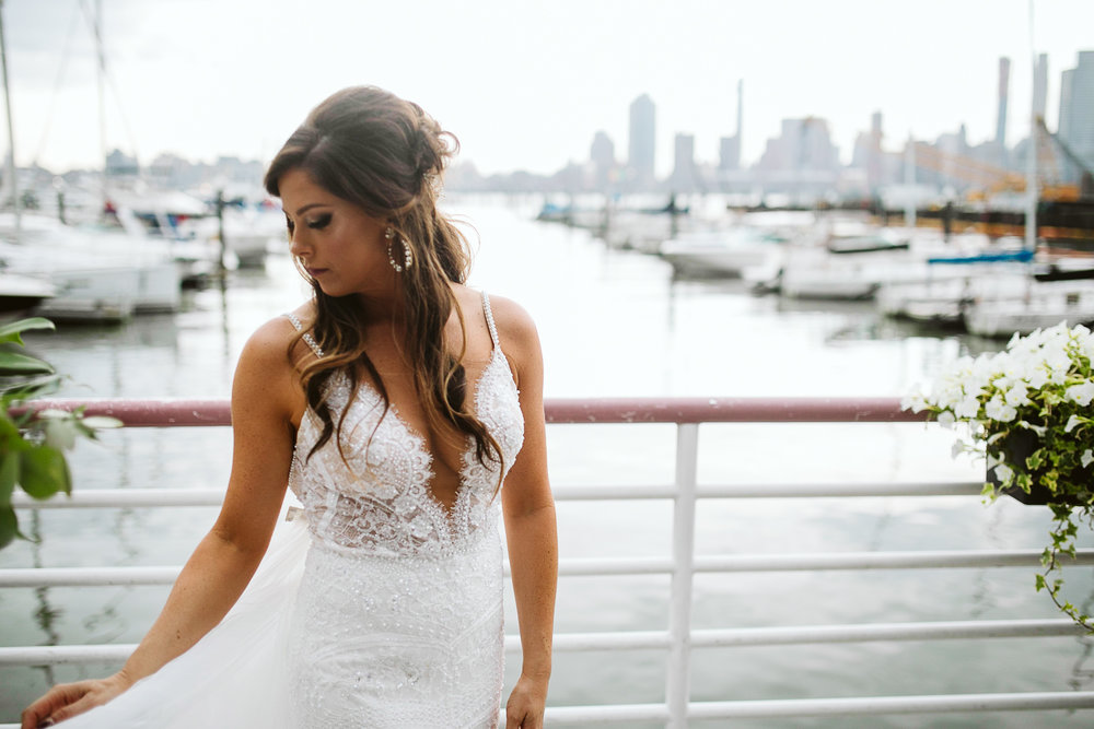A portrait of the bride with the marina in the background at this Battello Wedding in Jersey City, NJ