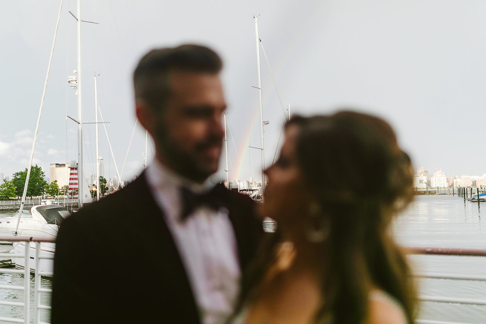 A portrait of the bride and groom at the marina at this Battello Wedding in Jersey City, NJ