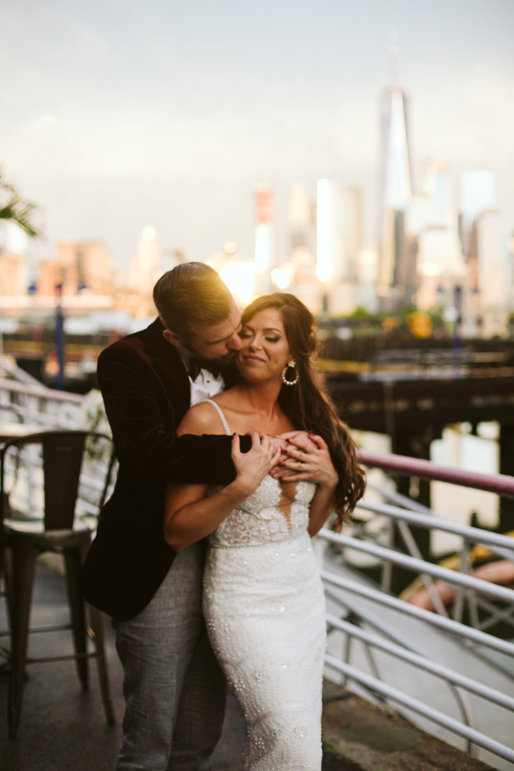 A portrait of the bride and groom with the NYC skyline at sunset at this Battello Wedding in Jersey City, NJ