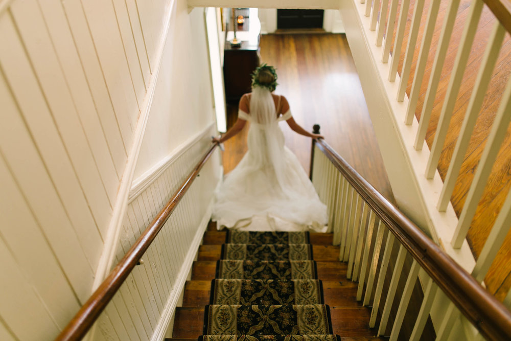 bride in gown on staircase