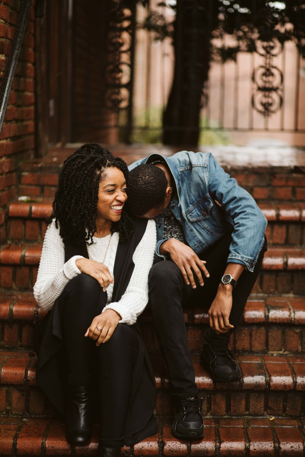engagement photos with couple sitting on brick stairs