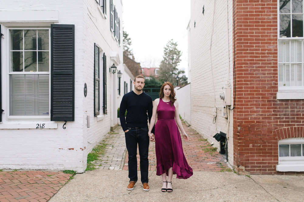 A leather jacket and maroon dress at this urban DC Area Engagement Shoot - Alexandria, VA