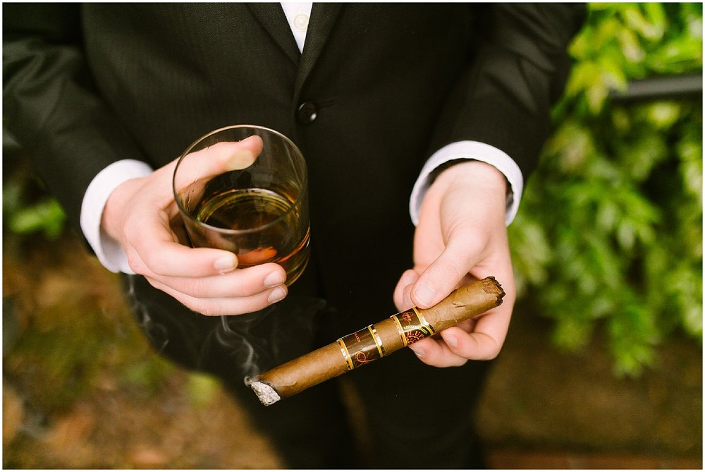 groom drinking whiskey on wedding day