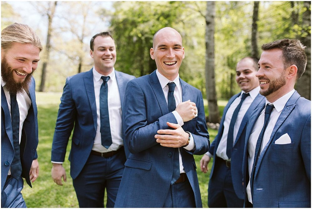 groomsmen and groom in navy suits