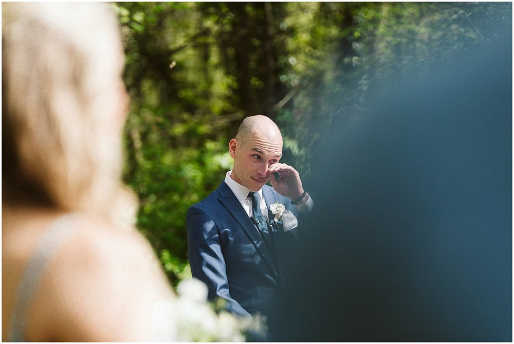 groom cries as bride walks down the aisle