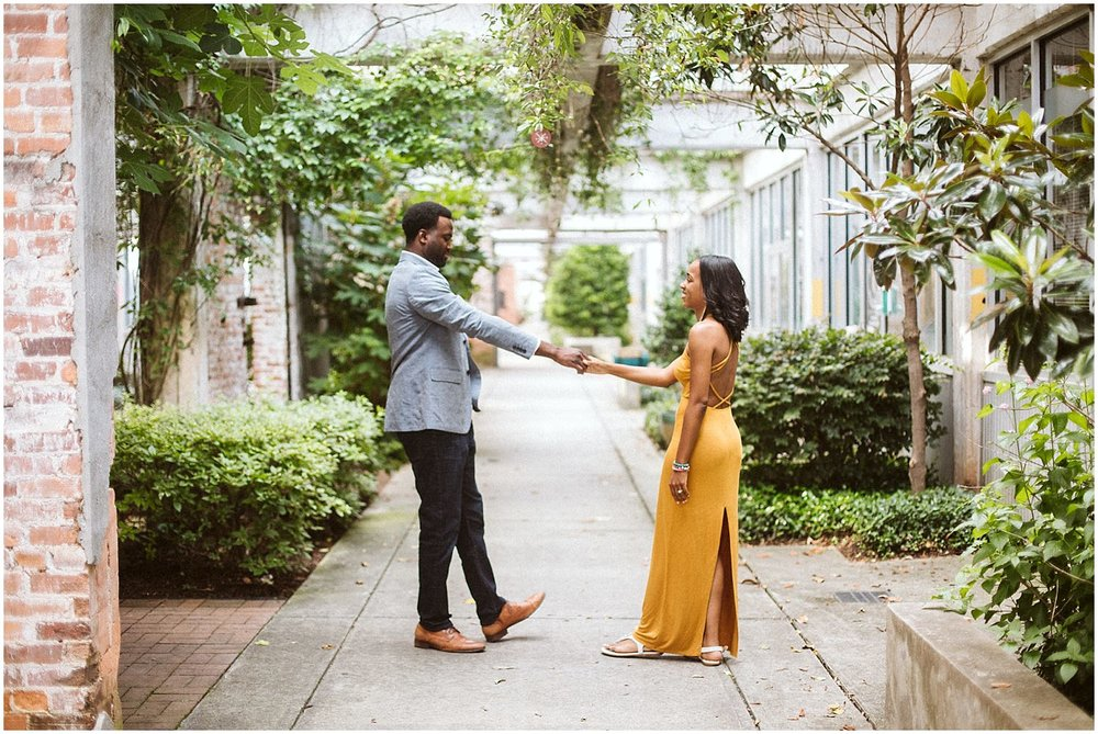 couple dancing for engagement session in atlanta