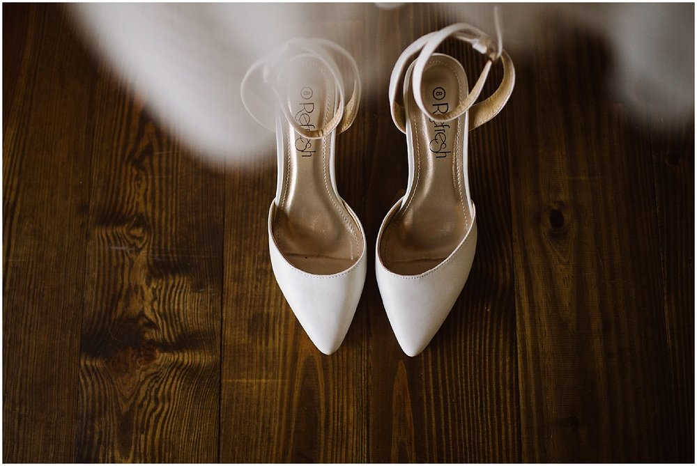 bride's white wedding shoes
