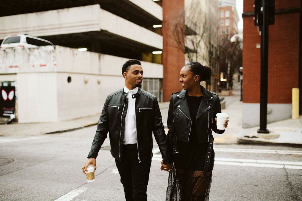 black couple wearing leather for engagement session