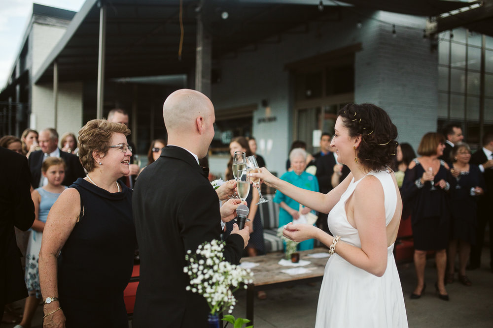 champagne toast at JCT kitchen and bar wedding