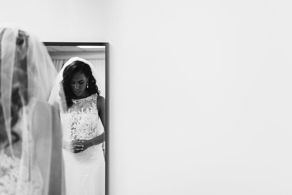 bride praying before st francis hall wedding