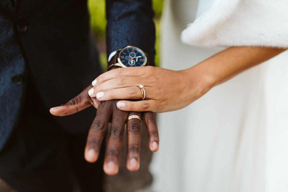 gold wedding bands worn by bride and groom at st francis hall wedding