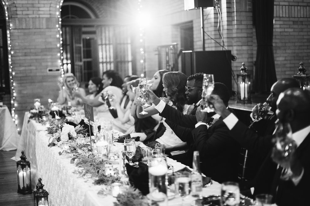 champagne toast during winter wedding at st francis hall in washington dc