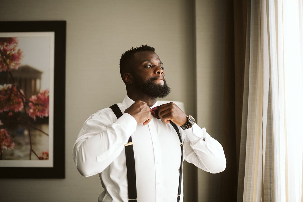 black groom getting ready for st francis hall wedding
