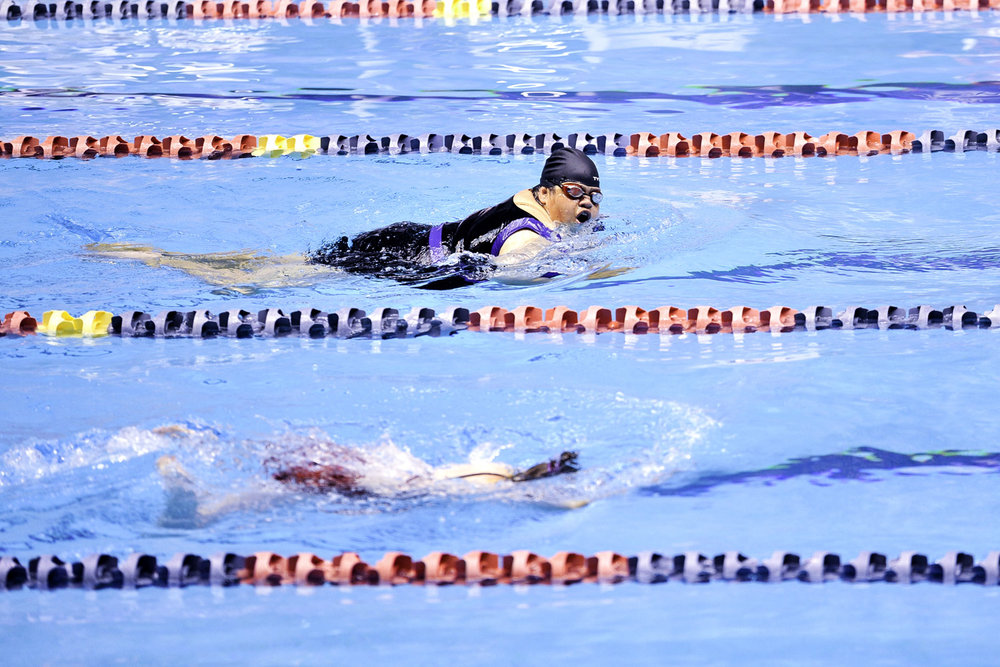 Tight race at the 50 meter breaststroke in the King County Aquatic Center in Seattle, Washington.