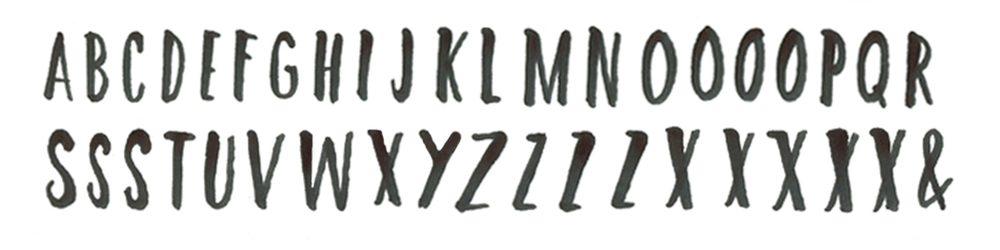 Using a brush tip, practicing the alphabet in my sketchbook.