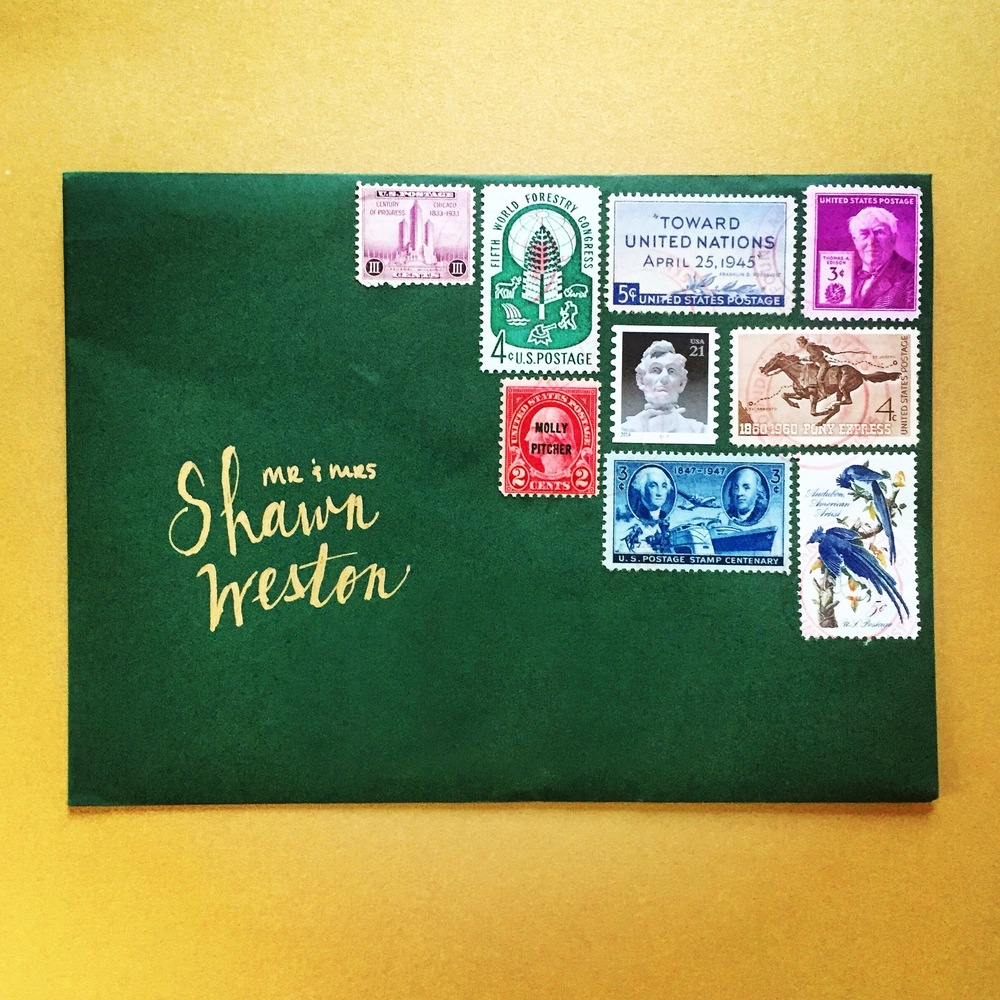The envelope designed by Frances for the invitations includes an assortment of stamps.